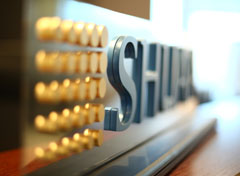 SHUAA Logo On Desk